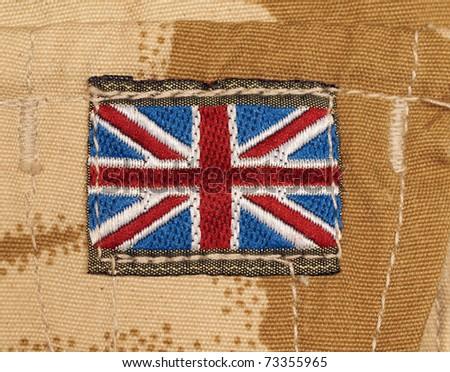 British Army Union Jack shoulder flash on desert DPM camouflage jacket - stock photo