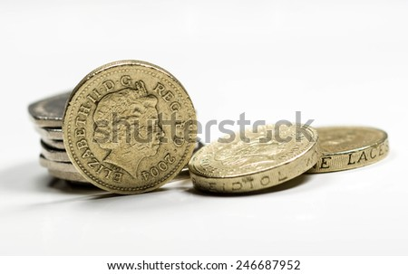 British coins. Focus on one pound portrait of Her Majesty Queen Elizabeth II, designed in 1998 by Ian Rank-Broadley. This design is used from 1998 to date. - stock photo