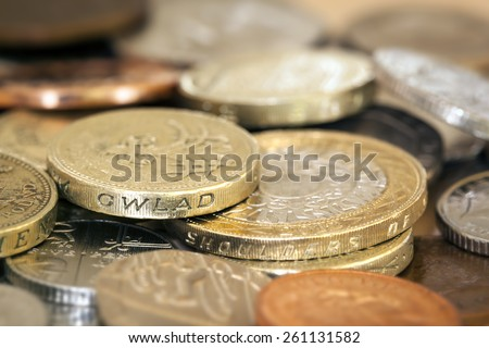 British coins in full frame background.  Shallow focus. - stock photo