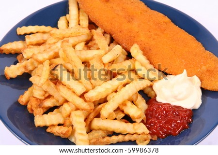 British cuisine: Fish and chips with ketchup and mayonnaise - stock photo