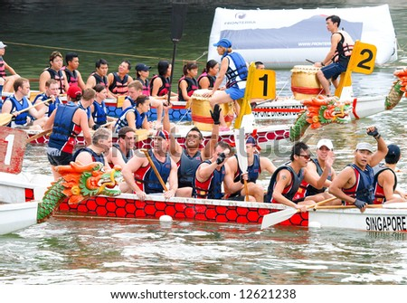 British dragons acknowledging cheers from supporters on shore after winning their challenge, , an event held in Singapore on 10 May 2008