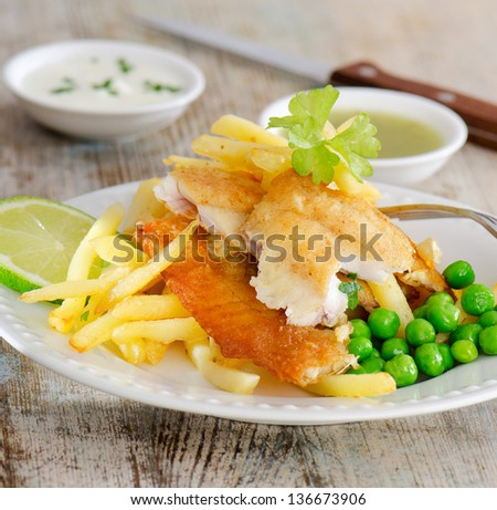 British food - fish and chips on a wooden table