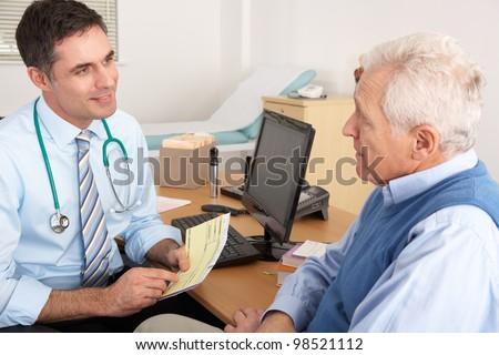 British GP talking to senior man in surgery - stock photo