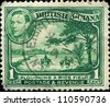 BRITISH GUAINA - CIRCA 1931: A stamp printed in British Guiana shows Ploughing of a rice field, circa 1931 - stock photo