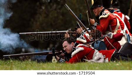British infantry during a re enactment of a War of 1812 battle at Fort Erie, Ontario, Canada. August 12/2006. - stock photo