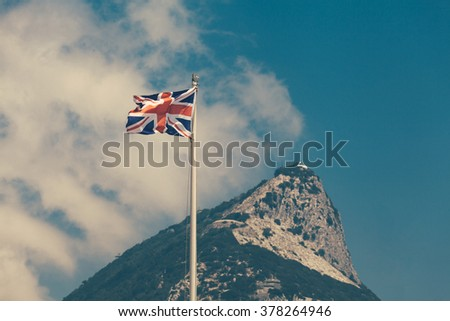 British overseas territory the Rock of Gibraltar and the flag of the United Kingdom. - stock photo