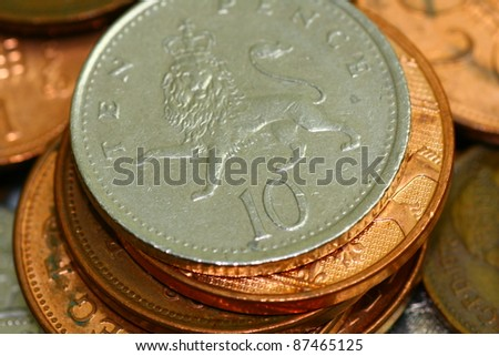 British 10 pence on a pile of coins - stock photo