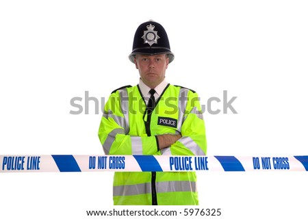 British Police officer standing behind some cordon tape. Focus is on the tape. - stock photo