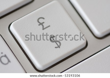 British pound and american dollar on a computer keyboard, concept exchange rate or online shopping - stock photo