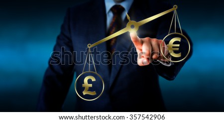 British pound sterling is outweighing the Euro sign on a golden virtual pair of balances. Business concept for currency conversion rate, investment risk and foreign exchange market trading. - stock photo