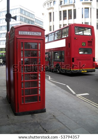 British red phone booth and Red Bus - stock photo