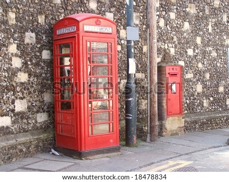 British red phone booth K6 & postbox against a Roman wall in Canterbury, Kent, UK - stock photo