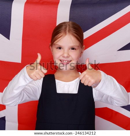British schoolgirl smiling at the background of the flag of England - stock photo