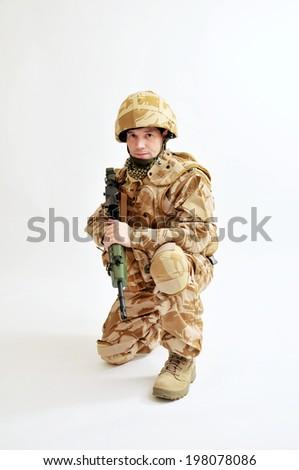 British Soldier In Desert Camouflage Uniform - stock photo