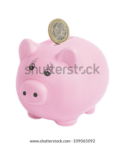 British two pound coin being inserted into piggy bank - isolated on a white bank background - stock photo