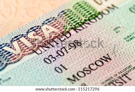 British visa entry and exit stamps in passport - stock photo