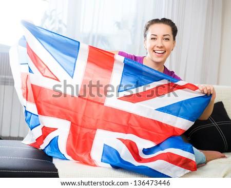 British woman holding the Jack Union flag - stock photo