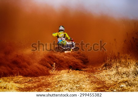 BRITS, SOUTH AFRICA - July 11:  Africa-Offroad Racing Rally,  on July 11, 2015 at Koster, North West Province, South Africa.  Quad Bike kicking up trail of dust on sand track during rally race.HD - stock photo