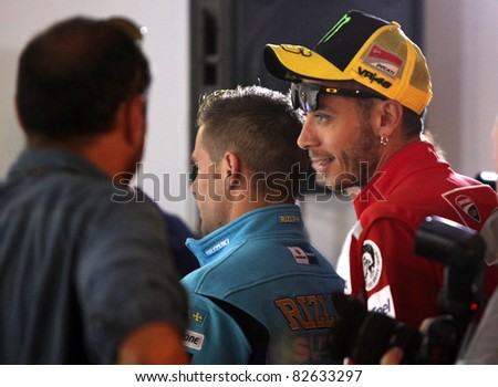 BRNO,CZECH REP.,AUGUST 11:MotoGP rider Valentino Rossi (R) of Ducati on press conference on Brno circuit  before next race of World Championship on August 11,2011 in Brno, Czech republic.
