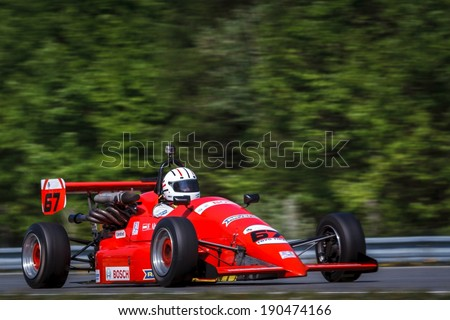 BRNO, CZECH REPUBLIC - APRIL 27, 2014: Franz Altmann behind the wheel of 1990 Renault 2.0 Formula L car during Formula Historic race at Brno Circuit.