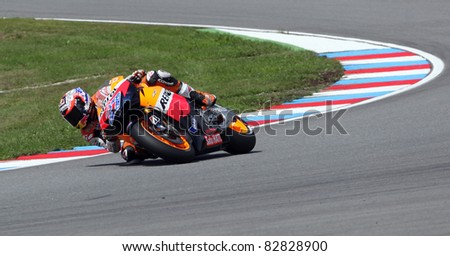 BRNO, CZECH REPUBLIC - AUGUST 14: Casey Stoner (No. 27) wins the MotoGP race in world championship on August 14, 2011, in Brno, Czech Republic. - stock photo