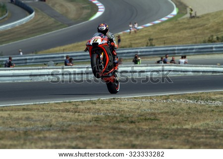 BRNO - CZECH REPUBLIC, AUGUST 14: German Aprilia rider Stefan Bradl at 2015 MotoGP of Czech Republic at Brno circuit on August 14, 2015