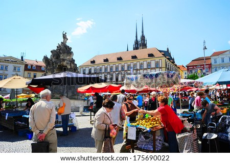 BRNO, CZECH REPUBLIC - AUGUST 29, 2013: Locals buying vegetables at street food Market in Brno . Brno is the second largest city in the Czech Republic.  - stock photo