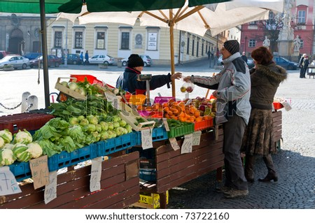 BRNO, CZECH REPUBLIC - MARCH 5: Locals buy vegetables at vegetables Market in Brno on March 5, 2011. Brno is the second largest city in the Czech Republic. - stock photo