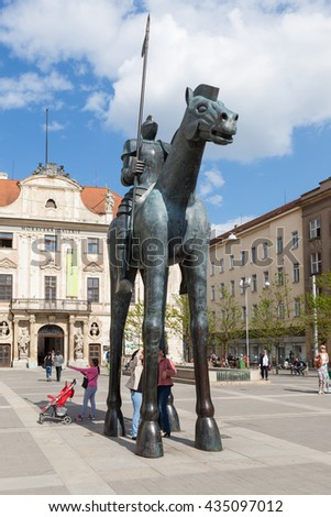 BRNO, CZECH REPUBLIC - MAY 11, 2016: People look under the horse statue from Brno in Czech Republic, which is made by Czech sculptor, painter, actor, educator, and writer Jarosla Rona - stock photo