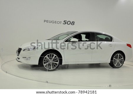 BRNO - JUNE 9: Peugeot exhibition presents new Peugeot 508 in the Brno motor show 2011, June 9, 2011 in Brno, Czech republic - stock photo