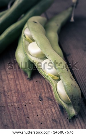 Broad Beans on a wooden Table - stock photo