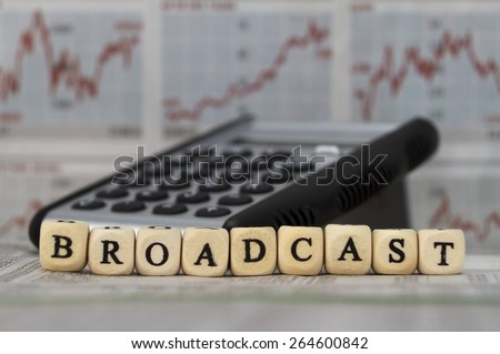 Broadcast word built with letter cubes - stock photo