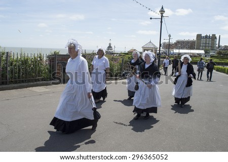 BROADSTAIRS,UK-JUNE 15: Militant Maids parade in Victorian costume during the annual Dickens Festival, in Broadstairs, Kent. June 15, 2015 in Broadstairs, UK. - stock photo