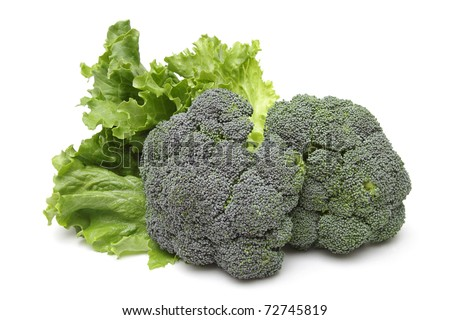 Broccoli and leafs of salad isolated on white background