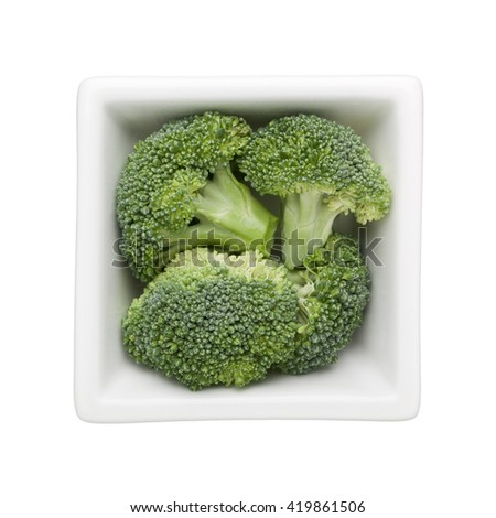 Broccoli in a square bowl isolated on white background - stock photo