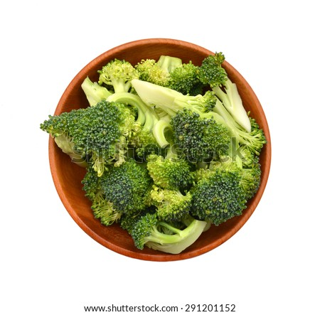Broccoli in wooden bowl on a white background seen from above - stock photo