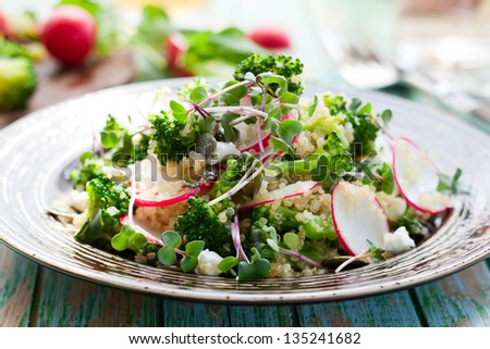Broccoli,radish and feta salad with quinoa - stock photo