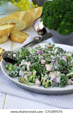 Broccoli salad with bacon and sunflower seeds. - stock photo