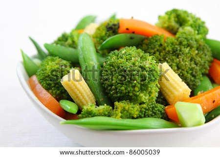Broccoli salad with carrot ,baby corn and snap pea - stock photo