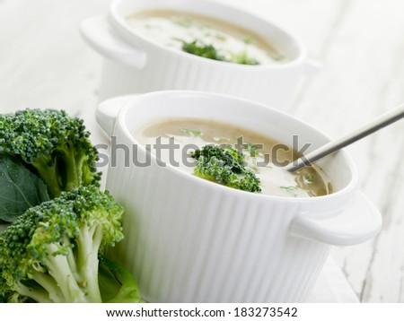broccoli soup on bowl over wood backgroun - stock photo