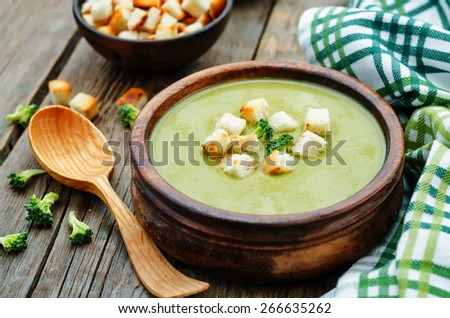 broccoli soup puree on a dark wood background. tinting. selective focus - stock photo