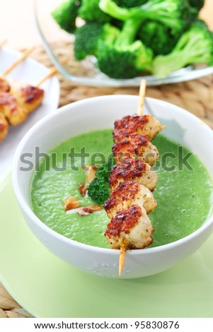 Broccoli soup roasted almond and skewered chicken - stock photo