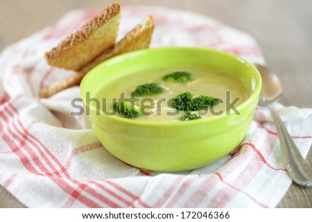 broccoli soup with almonds - stock photo