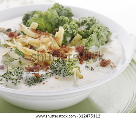Broccoli Soup with Smoked Gouda Cheese and Greens - stock photo