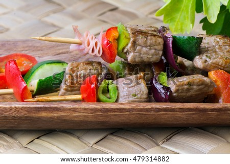 Brochettes of meat and vegetables, grilled on the barbecue