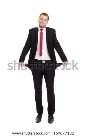 Broke businessman with empty pockets on white - stock photo