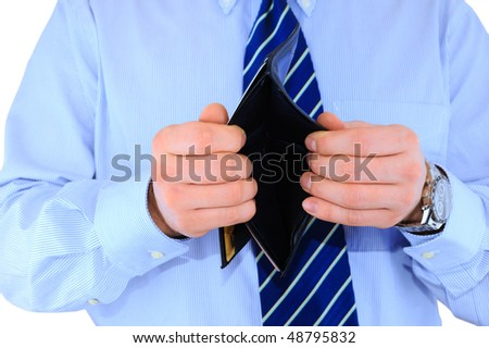 Broke businessman with empty wallet - stock photo