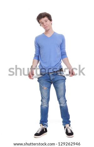 broke unemployed youth with empty pockets. - stock photo