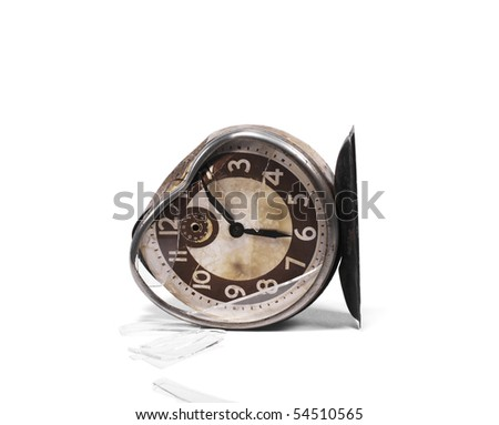 Broken alarm clock laying on side - stock photo