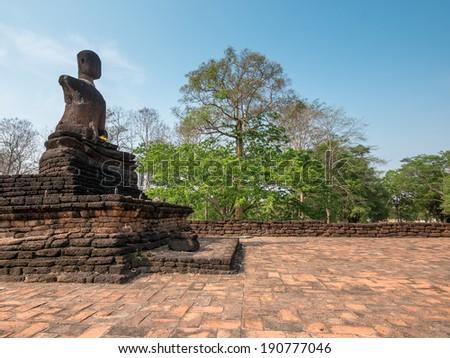 Broken ancient Buddha at Kamphaengphet Historical Park, Thailand - stock photo